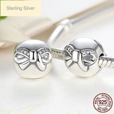 Stunning accessories for your Pandora or charm bracelet. Made with sterling silver, cubic zirconia and Murano glass, these beads and charms are a beautiful qual Pandora Style Charms, Silver Bow, Diy Jewelry Making, Bow Clip, Cufflinks, Charmed, Bows, Sterling Silver, Pendant
