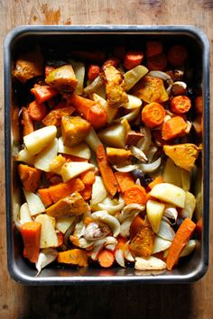 Roasted fall vegetables get a bright kick of freshness from lemon wedges and minced ginger that are tossed with the lot and roasted within.