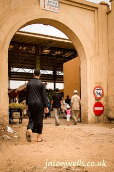Locals walking through one of the many entrances to the souk at Agadir, Morocco.   - Maroc Désert Expérience tours http://www.marocdesertexperience.com