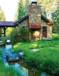 Cabin with a porch over the creek, love!