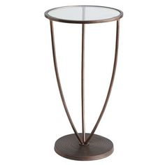 The Avenue Accent Table defies categorization. While its coiled metal base, stem-like curved legs and coppertone finish suggest a modern sensibility, Avenue's spare silhouette and clear, tempered glass top allow it to blend in beautifully with any style decor. And its light footprint is especially well-suited to small spaces where heavier pieces might overpower.