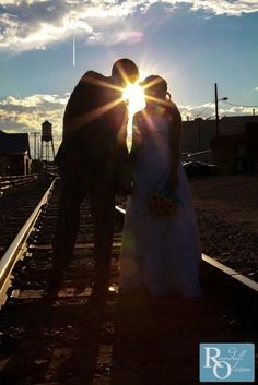 Bride and groom on train tracks, creative wedding photos, Colorado Wedding, Randall Olsson Photography