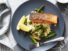 This beautiful asparagus and lemon risotto is simmered in white wine and garlic to create the creamiest, most flavoursome rice dish. Served with a piece of crispy-skin salmon, this makes a perfect dinner. Crispy Salmon Recipe, Salmon Recipes, Fish Recipes, Salmon And Rice, Salmon And Asparagus, Asparagus Dishes, Asparagus Recipe, Tart Recipes, Cooking Recipes