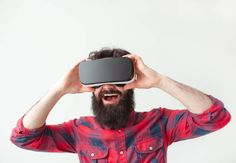 cheerful man adjusting the vr headset