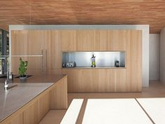 cozinha minimalista de madeira e aço | Bruno Erpicum & Partners