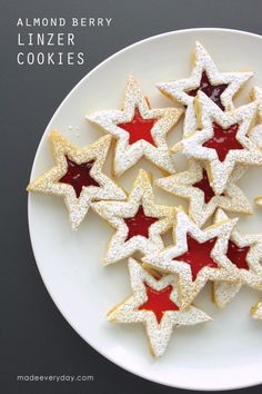 Almond Berry Linzer Cookies - they look like little stained glass windows...and smell like Christmas. Recipe on MADE Everyday.