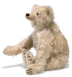 A STEIFF WHITE ROD BEAR, (28PB), jointed with metal rods, mohair, black boot button eyes, gutta percha nose, pink stitching under nose, black claw stitching, seam from ear to ear and elephant button, circa 1904 --16in. (40.5cm.) high (a bald spot on right arm and some other thinning)