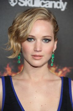 Jennifer Lawrence's sleek slide part and silky waves look chic and fresh. // #hair #beauty