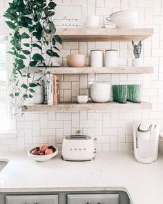 kitchen floating shelves, light natural wood and white herringbone subway tile