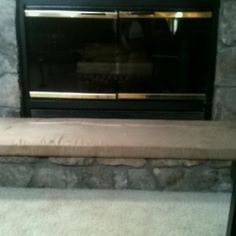 Solution to sharp edges on fireplace which cause close calls to child's face/head...DIY fireplace seat!! Need; plywood, fabric, staple gun/staples, roll out cushion. DYI; 1.measure space 2.cut wood cut to size 3.pick out and cut durable fabric to size, lay flat on flat surface 4. roll out padding & cut to size (slightly larger than wood to prevent sharp edges poking out), lay on top of fabric 5.place cut wood onto of laid out fabric & cushion 6.pull fabric tightly over on top of wood… Fireplace Seating, Diy Fireplace, Heart Diy, Staple Gun, Child Face, Childproofing, Cushion Fabric, Larger, New Homes