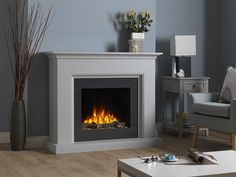 Shown in Terrano Grey finish with a high gloss Charcoal chamber, the Amalfi electric suite with its subtle curved detail creates an impressive focal point perfect for any living room. Suitable for flat wall fixing this electric suite does not require a chimney.