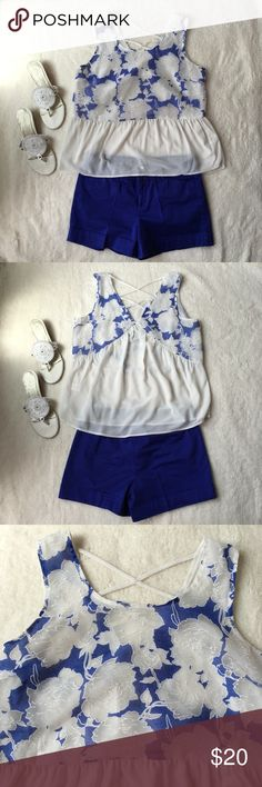 White and Blue Floral Peplum Beautiful top with an open back. Gently worn once. Boutique Tops