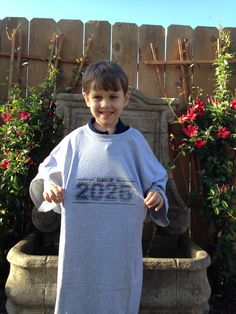 Class of 2026 - will take picture of him in this shirt every year until his senior year. Should fit him by then!