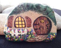 Fairy house, round door on rock