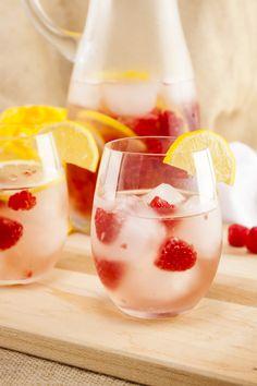 Sparkling Raspberry Lemonade Sangria (1 lemon 6 oz raspberries 1/4 cup Triple Sec 1 bottle sparkling white wine 1-2 Tbs sugar)