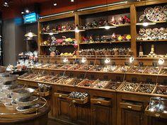 Chocolates everywhere. Chocolate Stores, Chocolates, Liquor Cabinet, Table Settings, Storage, Home Decor, Purse Storage, Decoration Home, Room Decor