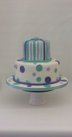 Turquoise and purple striped and polka dot first birthday cake.  . . .