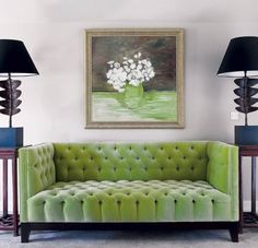 The best interior design ideas for using Pantone's colour of 2017, Greenery in your home. This beautiful green velvet sofa is a real focal point in the room and adds colour and texture to a space. Read the full article for more easy ways to add some spring-fresh greenery to your home.
