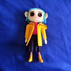 Coraline doll. Made with felt, yarn and buttons.