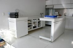 Got a small kitchen? Looking for ways to have enough work surface and storage? This convertible counter in the kitchen of the Nakagaike House in Tokyo, designed by Milligram Studio, has both. It pulls apart to show how counter work space can be doubled in order to prepare complicated meals. Open shelves on the stationary half of this dual-purpose cabinet make your kitchen gear readily accessible.
