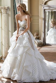 Brides: Hayley Paige. Ivory striped organza strapless bridal ball gown with sweetheart neckline, full flounced skirt, and taupe raw silk sash at natural waist with chapel train. Do not care for the strips, but love the style