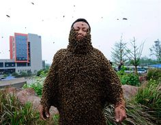 Bee keeping is a personal thing taken to the extreme this women has 33.1kg of bee's 331.000 to break the world record of 26.8 kg