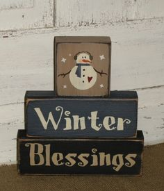 This Winter Blessings primitive wood snowman stacking blockset will make a nice shelf sitteraccent for your Christmasand winter holiday home décor.I have painted this set tan, blue and blackwith black underneath the topcoat formore of a primitive look.  (Also shown in burgundymiddle block) They have been distressed over the entire blocks. Measures approx. 8 x 9 high