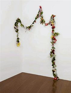 use green wire, thin twigs, & flowers to make garlands for parties