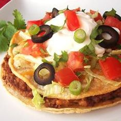 """Mexican Pizzas are delicious corn tortillas topped with beans, beef and all the delicious taco toppings you can imagine!"