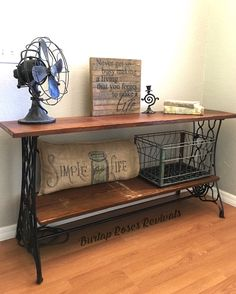 Antique singer sewing machine repurposed into a sofa table. @BurlapRosesRevivals Antique Console Table, Dining Room Sets, Entryway Tables, Antiques, Furniture, Home Decor, Dinning Room Sets, Antiquities, Homemade Home Decor