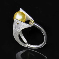 Holding On - Contemporary Jewelry- 14K Yellow Gold, Sterling Silver, Gold South Sea Pearl, Yellow Sapphire  by Maressa Tosto Merwarth