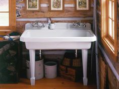 Classic Design Utility Sink with wide single bowl, four faucet holes, generous workspace, an integrated apron and backsplash, crafted from enameled cast iron; can be wall-mounted with coordinating legs, or installed on countertop (Harborview via Kohler)