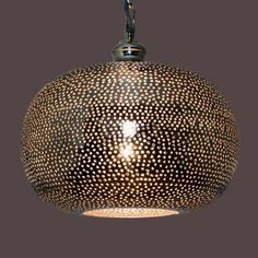 Designed with an intricate punch holed pattern, this circular ceiling pendant is fashioned in a champagne colourway and will make a striking statement in any li...