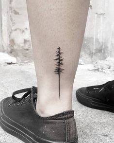 Minimalistic Pine tree, on the ankle tattoo Stella Luo Tattoos @stellatxttoo