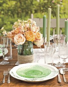Easy centerpiece: Wrap rope or twine around a simple Mason jar and fill with summer roses.