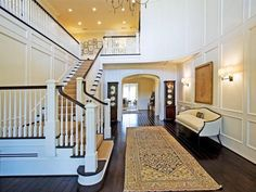 Long, open staircase; paneled walls