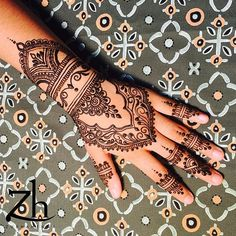 Some customers came prepared with saved images of henna designs from Google or the works of other henna artists. This is one of them.…