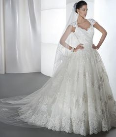 A Line Lace sweetheart neckline with sculpted straps and a low open back Bodice and skirt are embellished with embroidered lace appliques Hemline of the skirt is adorned with a rich, scalloped lace that flows into the chapel train  *NOTE* There are no sizes listed, because our wedding attire is custom made to fit each individual. After purchasing your gown, please send the following measurements to info@rdevine.com. Once we receive these measurements, we will be able to start designing your…