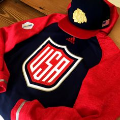R E P R E S E N T (Adidas WCOH Team USA Hoodie and Mitchell & Ness USA Cap)  Call 312-759-0079 to order! #BlackhawksStore #WCH2016 #teamusa