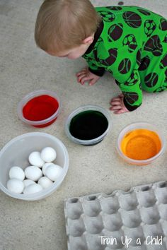 Tips for Dyeing Easter Eggs with Toddlers - A toddler friendly set up and suggestions for embracing the mess that comes with this cherished tradition.  Little ones love to explore colors and textures, and they will be delighted to watch what happens when they dunk an egg!