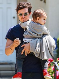 Gorgeous daddy Orlando Bloom—in dapper shades with translucent frames—held on tight to his oh-so-cute son Flynn, as the adorable duo strolled around Beverly Hills!