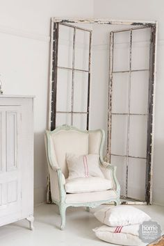 French Accent: Propped against the wall, behind the regal wingback chair from Vixen & Velvet, is an old French door.