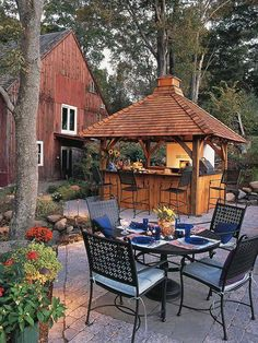 Transform the gazebo. Perfect for outdoor entertaining, this redesigned patio includes a colorful outdoor kitchen pavilion with bar seating for guests. Rustic brick pavers complement the bar's wood tones. Outdoor Living Rooms, Outside Living, Outdoor Spaces, Outdoor Decor, Rustic Outdoor, Outdoor Dining, Dining Area, Backyard Patio, Backyard Landscaping
