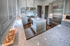 Lyra Silestone quartz kitchen countertops with whi Lyra Silestone, Silestone Countertops, Quartz Kitchen Countertops, White Countertops, Dark Brown Cabinets, White Cupboards, White Shaker Cabinets, Porcelain Farm Sink, White Porcelain
