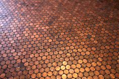 Floor tiled with pennies-- gorgeous.  Can do this for a wall too....