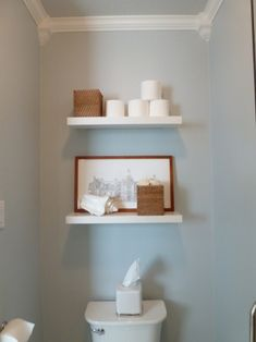 Floating shelves above the toilet... I do like this and I have 2 shelves!!