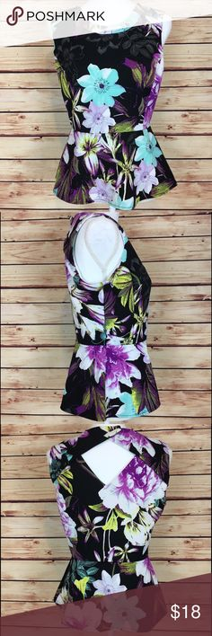 Worthington Floral Tank Top Peplum Keyhole Medium Worthington floral tank top. Black with purple, blue, and green floral print. Peplum. Keyhole back. Size medium. 93% polyester, 7% spandex. Excellent preowned condition with no flaws. Worthington Tops Tank Tops