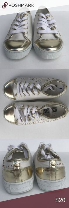 Michael Kors Girls Sneaker Michael Kors Ivy Dee White & Gold studded Girls Sneaker. Like new, has Price on sole, size 1, smoke free home. Michael Kors Shoes Sneakers