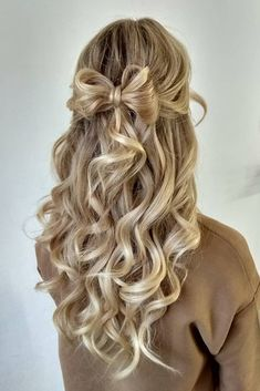 wedding hair half up half curly down with a bow of hair airforhair via instagram