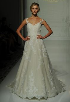 Pronovias ivory A-line wedding dress with lace cap sleeves and lace appliques and scalloped skirt Fall 2016 | https://www.theknot.com/content/pronovias-wedding-dresses-bridal-fashion-week-fall-2016